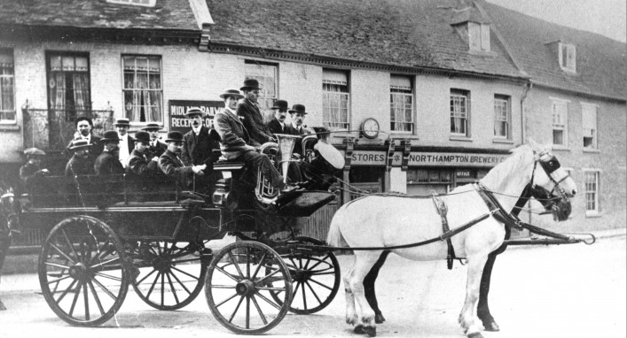 Thrapston band of musician in open-top horse-drawn carriage in Market Square